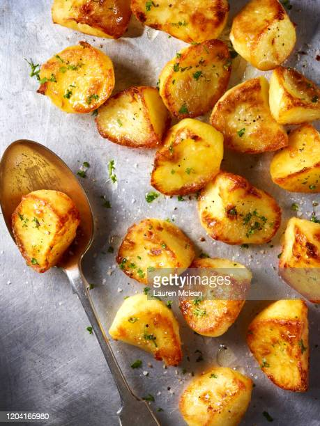 oven roasted potatoes - prepared potato stock pictures, royalty-free photos & images