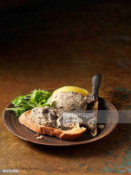 Oven roasted wild mushroom pate on crusty bread and rocket