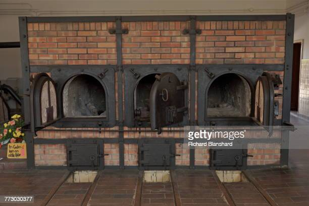 Ovens in the crematorium at the Buchenwald German Nazi concentration camp near Weimar Germany 2014 On the left are flowers and a message reading 'In...