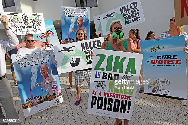 Over 100 protesters demonstrate on the steps of Miami Beach City Hall against the use of the pesticide 'NALED' being sprayed in Miami Beach to combat...