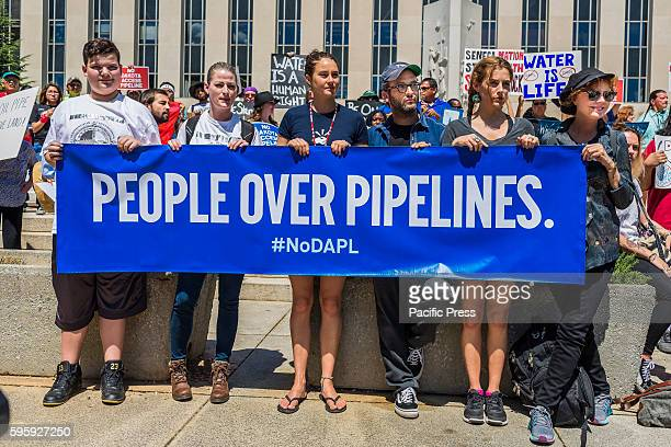Over 1000 activists including Shailene Woodley Josh Fox Riley Keough and Susan Sarandon rallied on the steps of the US District Court in Washington...