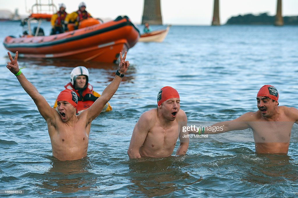 Over 1,000 New Year swimmers, many in costume, brave the freezing conditions in the River Forth in front of the Forth Rail Bridge during the annual Loony Dook Swim on January 1, 2013 in South Queensferry, Scotland. Thousands of people gathered last night to see in the New Year at Hogmanay celebrations in towns and cities across Scotland.