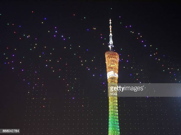 Over 1000 UAVs fly in formation during a welcoming banquet around Canton Tower on day two of the 2017 Fortune Global Forum on December 7 2017 in...