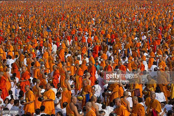Over 100000 buddhist monks and novices gather at Wat Dhammakaya Temple before the AlmOffering Ceremony to mark Earth Day and receive alms and...