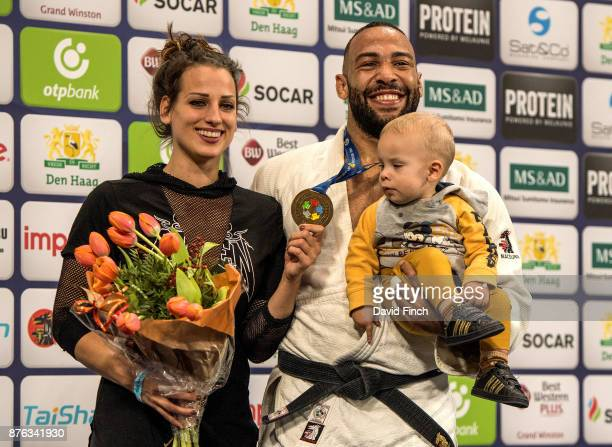 Over 100kg champion, Roy Meyer of the Netherlands stands on the top podium with his wife, Doree and their son Micah during the The Hague Grand Prix,...