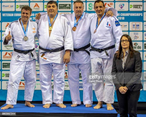 Over 100kg M5 medallists LR Silver Viorel Marinescu Gold Rob Kroonen Bronzes Stefan Cristescu and Miled Trabelsi The medals were presented by...