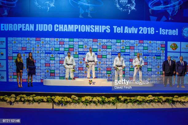 Over 100kg medallists LR Silver Tamerlan Bashaev Gold Lukas Krpalek Bronzes Stephan Hegyi and Henk Grol The medals were presented by Oleksandr...