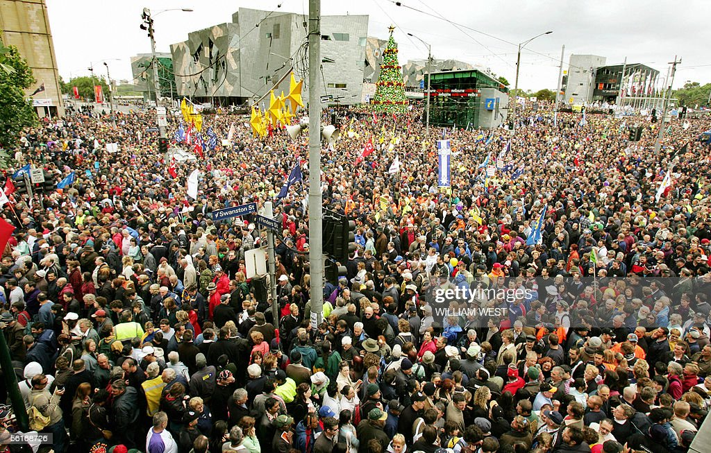 Over 150,000 workers prepare to march through the streets of central Melbourne, 15 November 2005, in what unions call the biggest protest in Australia's history against John Howard's labour reforms. The central business districts of major cities were brought to a halt by masses of chanting marchers accusing Howard's Liberal-National coalition attacking fundamental worker's rights and trying to crush the trade unions. AFP PHOTO/William WEST
