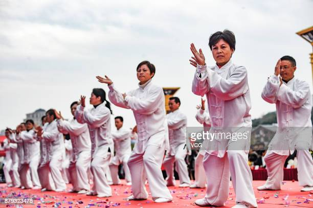 Over 2000 people stand in the formation of Tai Chi pattern and perform Tai Chi during a festival on November 25 2017 in Nanchang Jiangxi Province of...