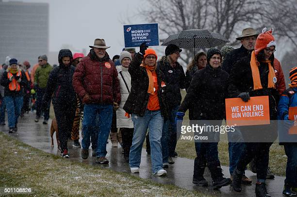 Over 250 people walk around Cheeseman Park during a Moms Demand Action to end gun violence rally December 12 2015 The rally marked the third...