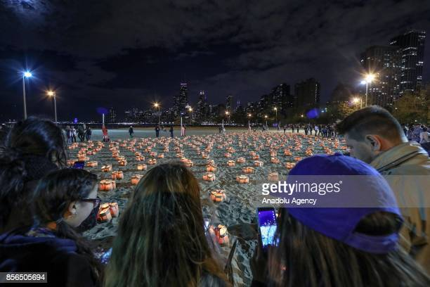 Over 2,500 candles are lighted for domestic violence victims during the traditional commemorative ceremony held to draw attention to domestic...