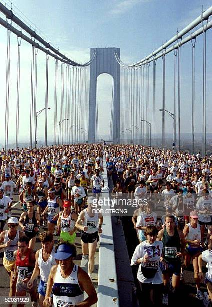 Over 25000 runners cross the VerrazanoNarrows Bridge 14 November 1993 at the start of the 1993 New York City Marathon Andres Espinosa of Mexico won...