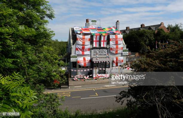Over 300 flags adorn the Robin pub as it is decorated ahead of the World Cup on June 12 2018 in Jarrow England Managers Clare McFall and Norman Scott...
