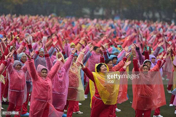 Over 4000 citizens perform square dance in the rain to make a Guinness World Record with dancers in other 13 cities on November 7 2016 in Jinan...