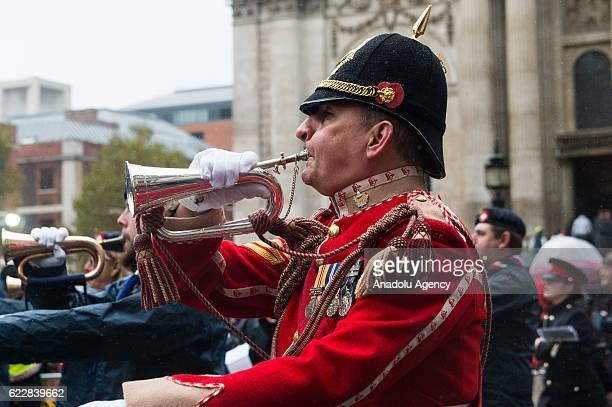 Over 7000 performers representatives of the armed forces and professions representing various trades walk past St Paul's Cathedral at Lord Mayor's...