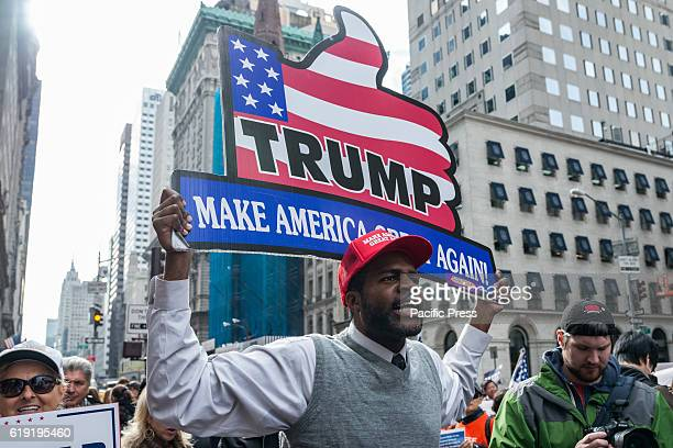 Over a hundred supporters of Republican Presidential nominee Donald J. Trump rallied on the sidewalk in front of Trump Tower on Manhattan's Fifth...