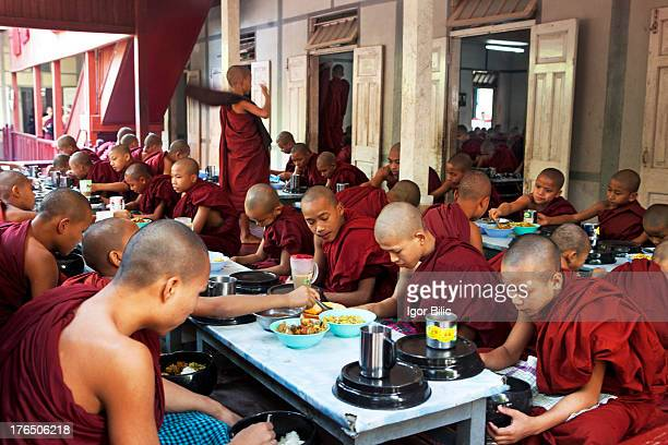 Over a thousand monks line up for lunch every day at Amarapura Mahagandayon monastery in Mandalay, Myanmar. Regardless of all the tourists around...