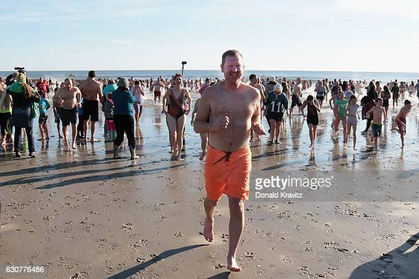 Over a thousand spectators watched more than 500 brave participants as they exit the Atlantic Ocean during First Day At The Beach on January 1 2017...