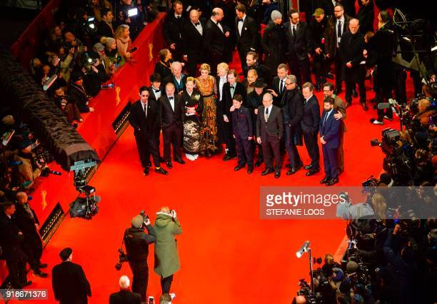 Over all view shows photographers surrounding the team of the opening movie Isle of Dogs among them US actor Bill Murray Japanese actress Mari...