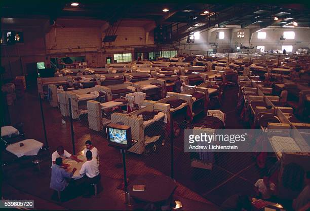 Over crowding at the DUal Vocational Institute a California prison is so intense that the gym was converted into a dorm room to house prisoners The...
