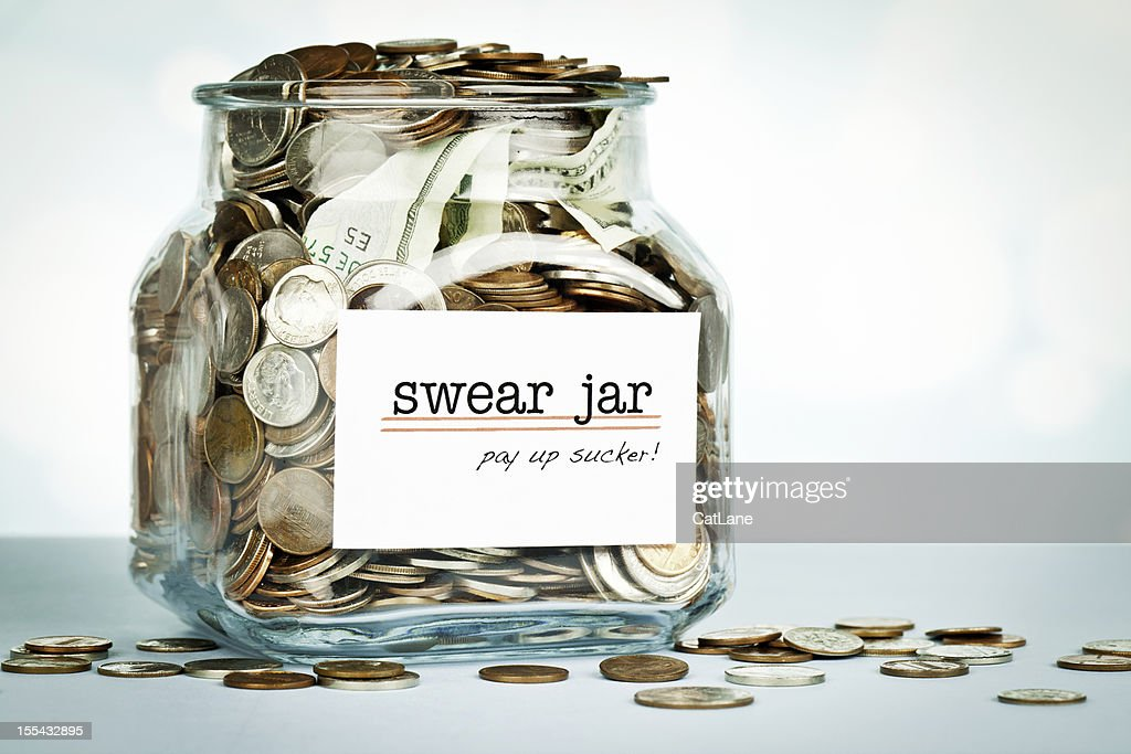 Over Flowing Swear Jar : Stock Photo
