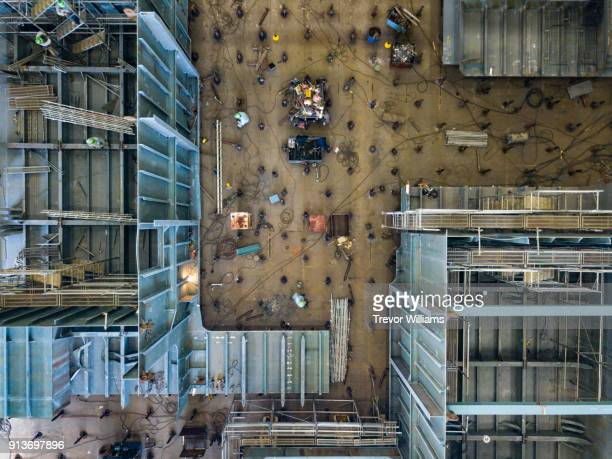 Over head view of iron workers welding in a shipbuilding factory