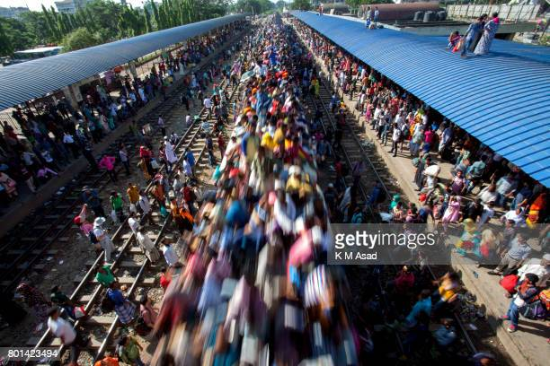 A over loaded train move for people travel to their village in Dhaka Millions of Bangladeshis are expected to travel home Journeys on overcrowded...