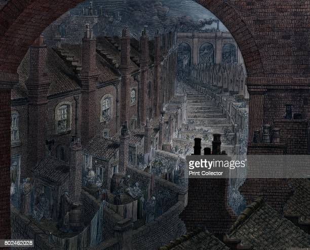 Over London by Rail' 1872 Men and women in the back yards of tenements in the East End of London with a steam locomotive passing over a bridge in the...