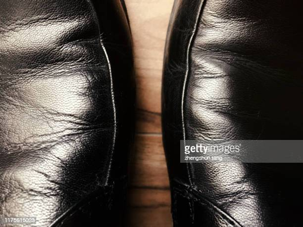 over looking of two leather shoes. - loafers stock pictures, royalty-free photos & images