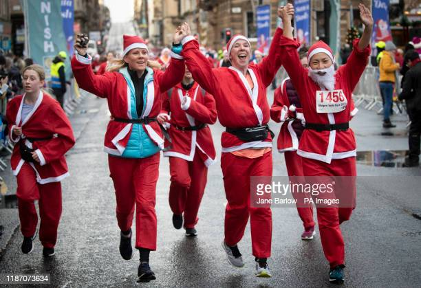 Over seven thousand members of the public taking part in Glasgow's annual Christmas Santa dash through the city centre The Santa Dash has been held...