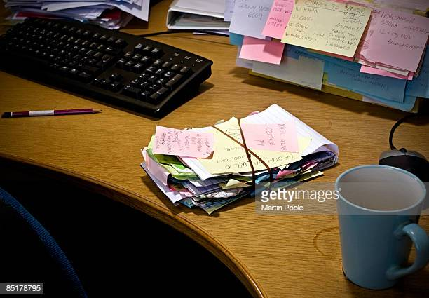 over stuffed note book on desk  - handwriting stock pictures, royalty-free photos & images
