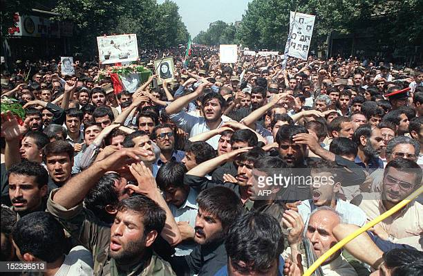 Over tenthousand Iranians joined in carrying 72 coffins 07 July 1988 in Tehran during the funeral service for those who died when an Iran Air...