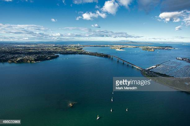 over the bridge - waitemata harbor stock photos and pictures