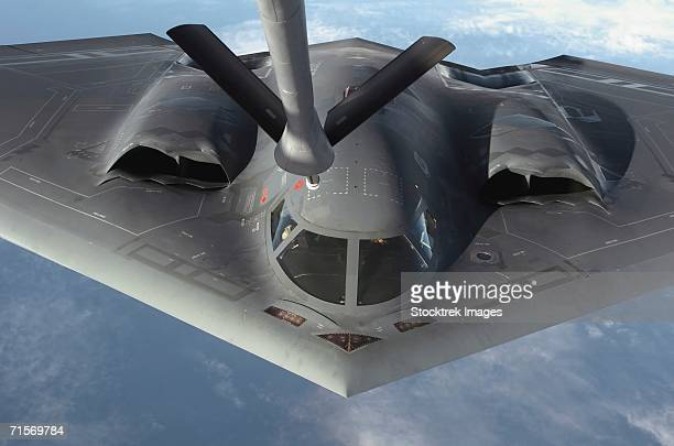 """Over the Pacific Ocean - A  B-2 Spirit bomber prepares to refuel from a KC-135 Stratotanker during a deployment to Andersen Air Force Base, Guam.  """