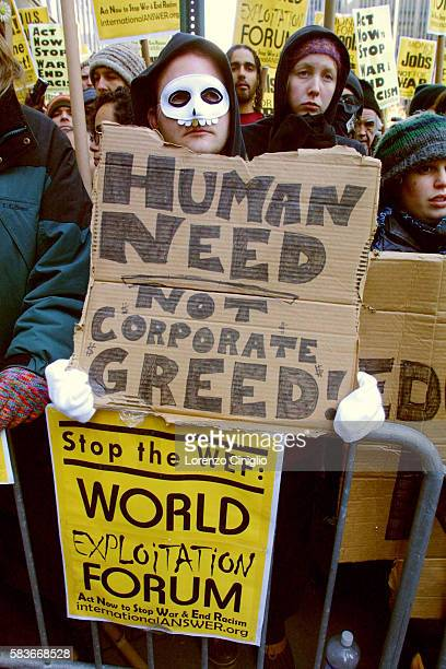 Over two thousand protesters turned out to demonstrate against the World Economic Forum at the WaldorfAstoria Hotel A masked protestor holds a sign...