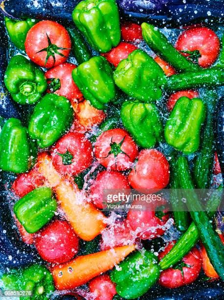 Over view of water falling on vegetable