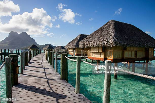 over water resort in a tropical sea. - bora bora imagens e fotografias de stock