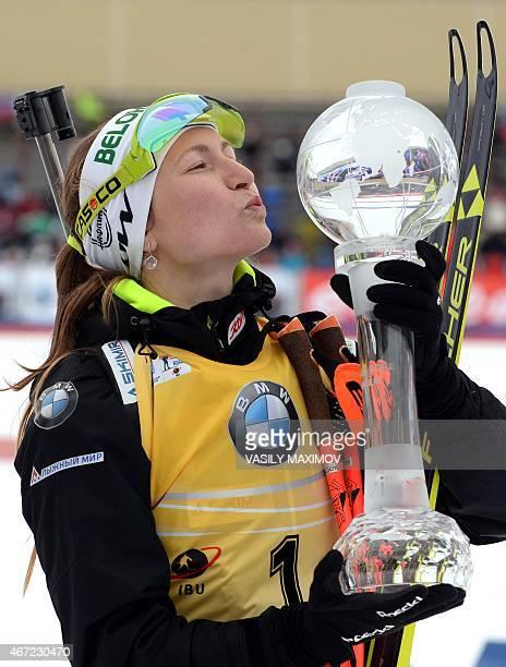 Overall Biathlon World Cup champion Belarus' Darya Domracheva kisses her allseason Crystal Globe trophy on the podium after the women's 125 km mass...