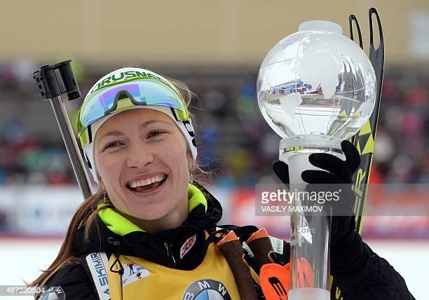 Overall Biathlon World Cup champion Belarus' Darya Domracheva celebrates with her allseason Crystal Globe trophy on the podium after the women's 125...