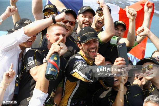 Overall champion JeanEric Vergne of Techeetah Formula E Team poses with team members on July 14 2018 in New York City