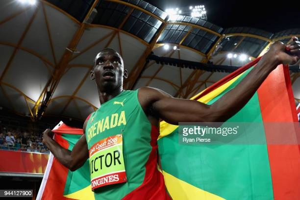 Overall gold medalist Lindon Victor of Grenada celebrates after the Men's Decathlon 1500 metres during the Athletics on day six of the Gold Coast...