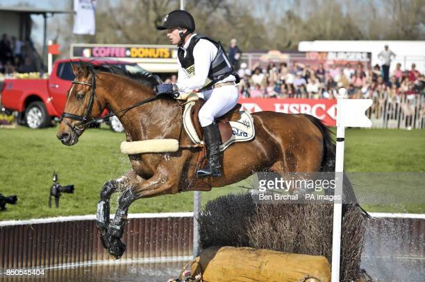 Overall leader Germany's Michael Jung clears the brush jumps in the Lake on La Biosthetique Sam Fbw on the crosscountry during day four of the...