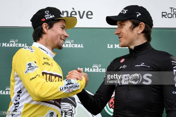Overall leader Slovenia's Primoz Roglic is congratulated by third placed Britain's Geraint Thomas during the podium ceremony of the 5th and final...
