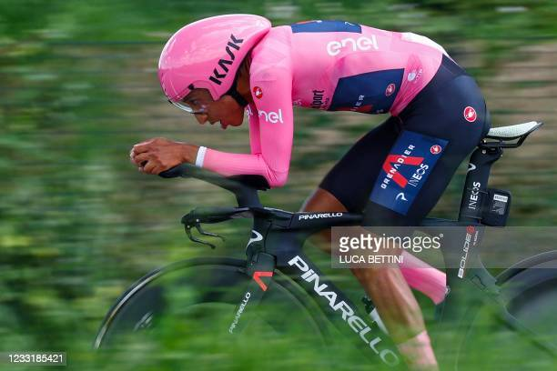 Overall leader Team Ineos rider Colombia's Egan Bernal rides during the 21st and last stage of the Giro d'Italia 2021 cycling race, a 30.3km...