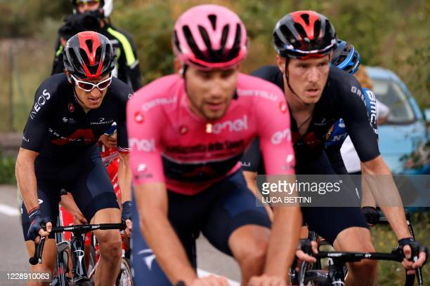 Overall leader Team Ineos rider Italy's Filippo Ganna, wearing the pink jersey and Team Ineos rider Great Britain's Geraint Thomas ride behind on...