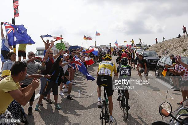 Overall leader's yellow jersey Britain's Christopher Froome rides after Colombia's Nairo Quintana during the 2425 km fifteenth stage of the 100th...