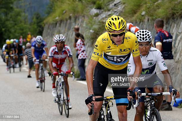 Overall leader's yellow jersey Britain's Christopher Froome rides next to best young's white jersey Colombia's Nairo Quintana during the 1725 km...