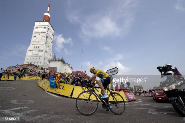 Overall leader's yellow jersey Britain's Christopher Froome rides to win during the 2425 km fifteenth stage of the 100th edition of the Tour de...