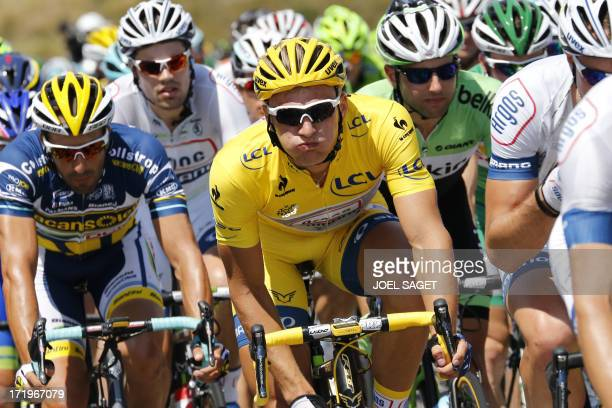 Overall leader's yellow jersey Germany's Marcel Kittel rides in the pack during the 156 km second stage of the 100th edition of the Tour de France...
