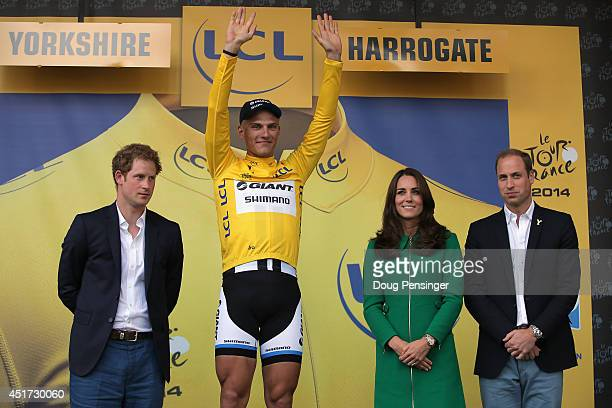 Overall race leader Marcel Kittel of Germany and Team Giant-Shimano is presented by Prince Harry , Catherine, Duchess of Cambridge and Prince...